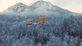 Aerial view of Hohenschwangau Castle at sunrise in winter landscape. 46636756