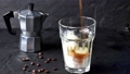 Pouring in glass with ice cream ice coffee 46667433