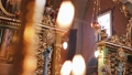 Orthodox, Christianity, church. Beam of light shines over old gondel chandelier with candles hanging 46780877
