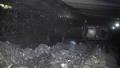 Coal miner produces coal. Coal mining in a real mine 46784773