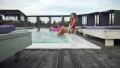 Beautiful girls have fun in the outdoor swimming pool creating huge water splashes by slim slender 46809715