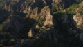 flying over the sharp rocks with ancient little fortress in georgia 46837014