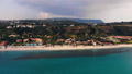 Dark cloud over blue sea and shoreline with hotel and resort buildings. Aerial shot 46891082