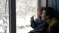 Family Admiring Christmas Snowfall 46892804