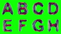 Alphabet made of low poly style isolated on green background. 47092527