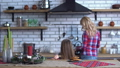 Pretty mother in plaid shirt with long blond hair cooking breakfast and little girl bite one cookie 47158268