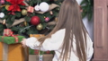 Little cute girl with long brown hair sitting near christmas tree and open presents 47158719