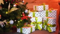 gift boxes on sheepskin at christmas tree 47175406
