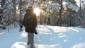 Young woman with professional photo camera in the winter forest. 47218863