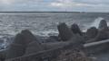 Waves breaking on concrete breakwaters. Sea storm. 47220899