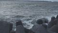 Waves breaking on concrete breakwaters. Sea storm. 47220902