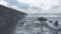 Waves breaking on concrete breakwaters. Sea storm. 47220909