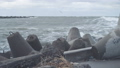 Waves breaking on concrete breakwaters. Sea storm. 47220912