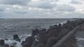 Waves breaking on concrete breakwaters. Sea storm. 47220942