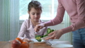 Little girl do not want to eat vegetables and dislike taste of broccoli and spinach. 47225593