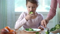 Little girl do not want to eat vegetables and dislike taste of broccoli and spinach. 47225624