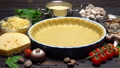 shortbread dough for baking quiche tart and ingredients in baking form 47241633