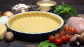 shortbread dough for baking quiche tart and ingredients in baking form 47241649