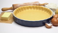 shortbread dough for baking quiche tart and ingredients in baking form 47241653
