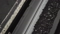 An overview of a moving belt conveyor with a coal at the coal mine 47288002