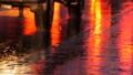 Cars in traffic, headlights in rain on asphalt, view below. Rain hits the puddles at night 47302418