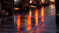 Cars stand in traffic, headlights in rain on asphalt, view below. Rain hits the puddles at night 47302448