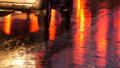Cars in traffic, headlights in rain on asphalt, view below. Rain hits the puddles at night 47302833