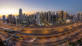 Dubai marina with traffic on sheikh zayed road panorama day to night timelapse lights turn on. 47494804