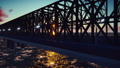 The camera flies along the railway bridge at sunset. Looped realistic animation 47540688