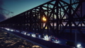 The camera flies along the railway bridge with cars and train at sunset. 47569752
