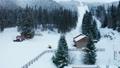 Aerial pan up of ski slope 47646914