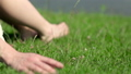 A girl sits on the green grass by the river 47658505