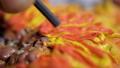 macro artist makes sunflower with plasticine and tool 47730912