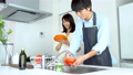 Young couple washing dishes 47770407