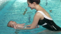 Mother and baby swimming 47792837