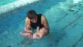 Coach teach baby to dive 47793101
