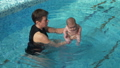 Coach with baby in the pool 47793103