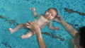 Baby learning to swim 47793116