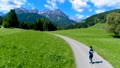 Woman jogging outdoors. Italy Dolomites Alps 47797980