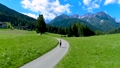 Woman jogging outdoors. Italy Dolomites Alps 47797981