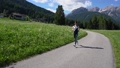Woman jogging outdoors. Italy Dolomites Alps 47797984