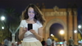 Happy woman texting in smartphone at night in Barcelona 47846119