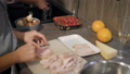 Close-up of several freinds cooking dinner and preparing for home party, night together with friends 47864623