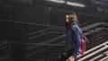 Beauty girl cheerfully slide along railing metro against background black stone 47942685