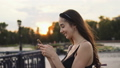 Beautiful girl model look messages in cell phone closeup sunset and smile cutely 47942687