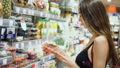 Beautiful girl model in food store chooses fresh berries diet. Proper nutrition. 47942689
