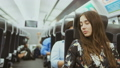 Beautiful woman after long journey rides tired on bus and tries to sleep on way 47942713