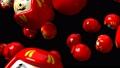 Red daruma dolls on black background 47945600