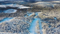 Aerial view of a winter snow covered forest in a sunny day, Taiga, Siberia. Footage. Panoramic view 47982046