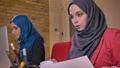 Closeup shoot of two young muslim female employees 48037886